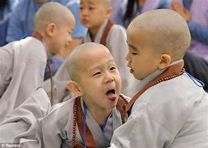 Young monks in south Korea cry as their heads are shaved ...