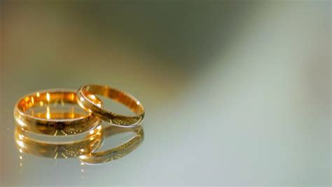 rose gold wedding rings turning on white background with