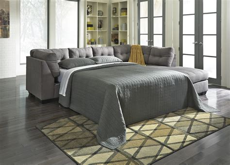 signature furniture warranty 2 sectional w sleeper sofa right chaise by benchcraft wolf and gardiner wolf furniture