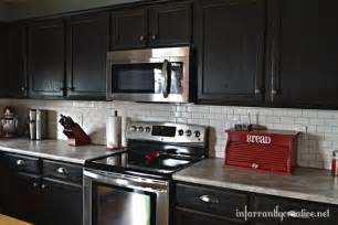 hometalk white subway tile backsplash with black cabinets