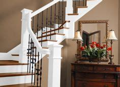 two story foyer with carriage lantern and dark stained