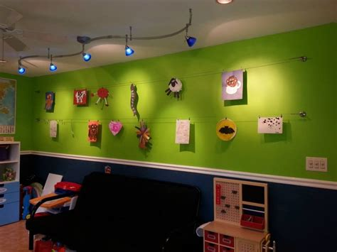 our playroom art wall with ikea wire hangers up to 197