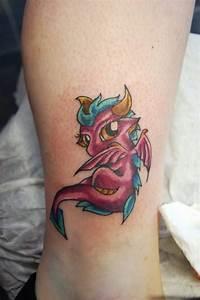 girl tattoo designs dragon: Tattoo on Leg For Girls