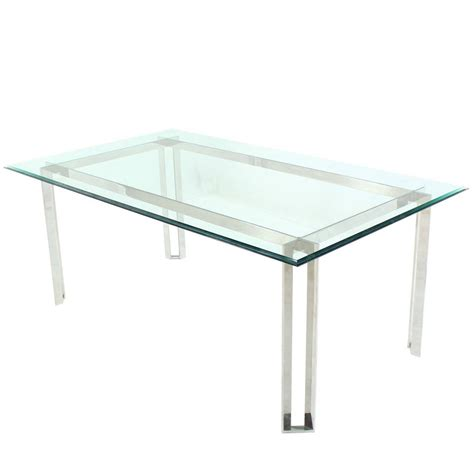 polished stainless steel  thick glass top dining room