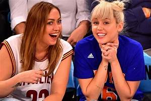 Miley Cyrus flashes her massive engagement ring and looks ...