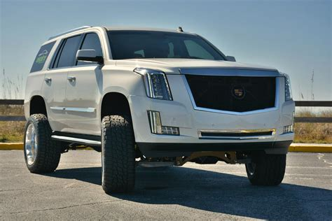 lifted cadillac escalade wears   american force
