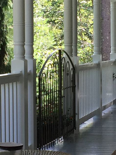 nice wide wrought iron gate  deck