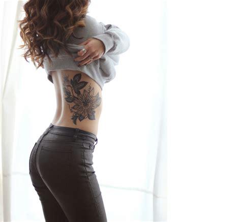 side  flower tattoo tattoo placements tattoos