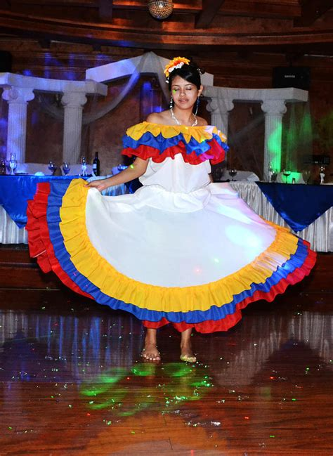 The cumbia is mainly accompanied by an. Colombian Dance Photograph by George Bostian