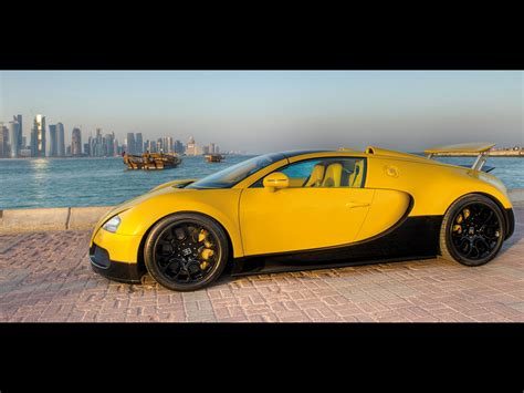 yellow bugatti 2012 bugatti veyron grand sport black yellow at qatar