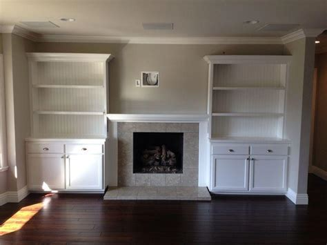 custom white wall unit with bookshelves a customer favorite in southern built in shelves around fireplace photos