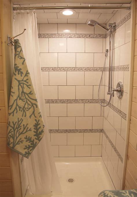 shower  horizontal stripes  biltmore stone mosaic  white ceramic tile bathrooms