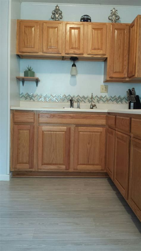 gray kitchen floors with oak cabinets honey oak kitchen cabinets with gray pergo willow lake