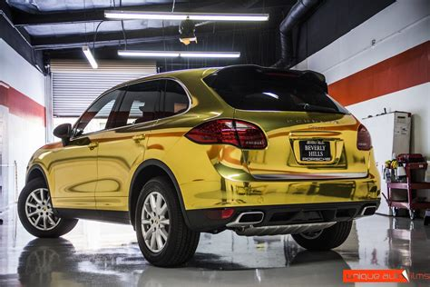 gold porsche truck project 24k gold porsche cayenne gold chrome vinyl wrap