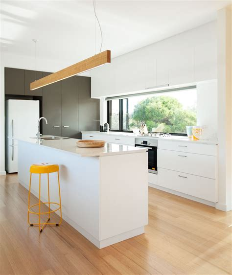 kitchen island bench lighting white bench top and cabinets joinery kitchen archiblox 4996