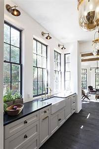 white kitchen cabinets with black and gold hardware With best brand of paint for kitchen cabinets with old window frame wall art