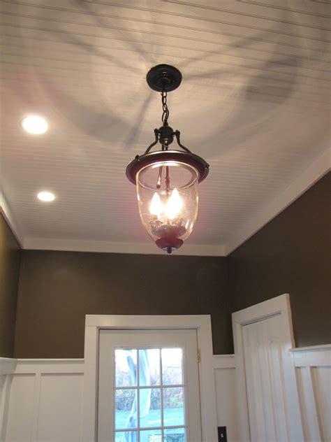 brass pendant light turned  pottery barn style