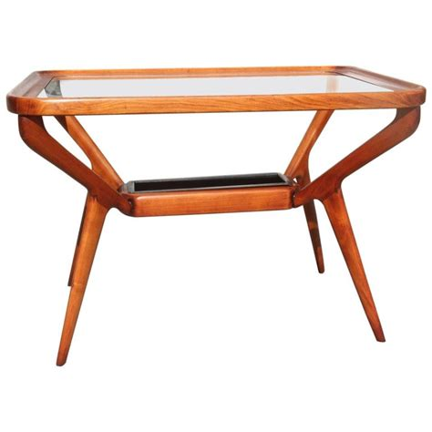 Try a mix of real wood in a finish like cherry or mahogany mixed with the airiness of a glass top. Midcentury Coffee Table Cherry Wood Rectangular Form Glass Top 1950s Dassi For Sale at 1stdibs