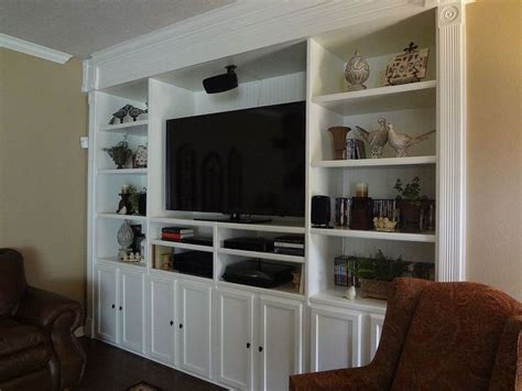 using kitchen cabinets for entertainment center custom built entertainment center hometalk 9575