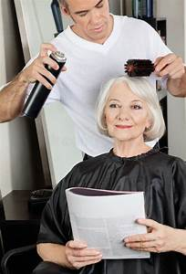 Hairstylist Setting Up Client's Hair At Salon Royalty Free ...