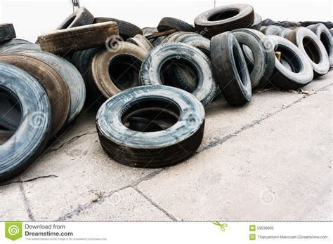 Tires Heap On Cement Ground Near Wall, Used Car Tires
