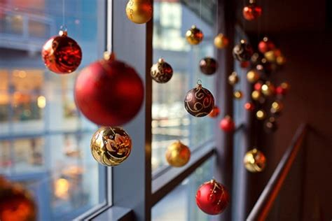 hanging christmas ornaments in window window christmas balls