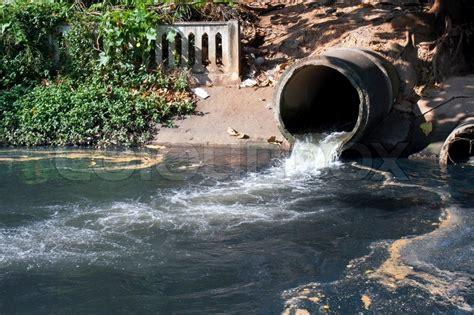 dirty drain water pollution  river stock photo