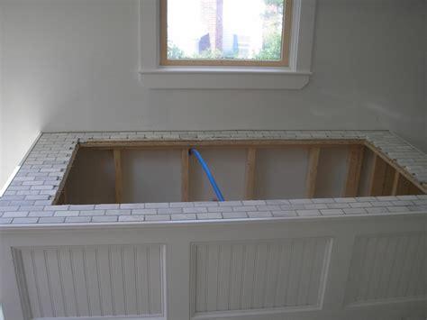 Tiling A Bathtub Deck by Best 25 Tub Surround Ideas On Bathtub
