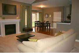 7 Living Room Interior Paint Colors The Neutral Colors Are White And Tan The Accented Color Is Green And