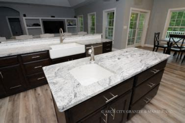 viscon white granite countertops   white farm sink