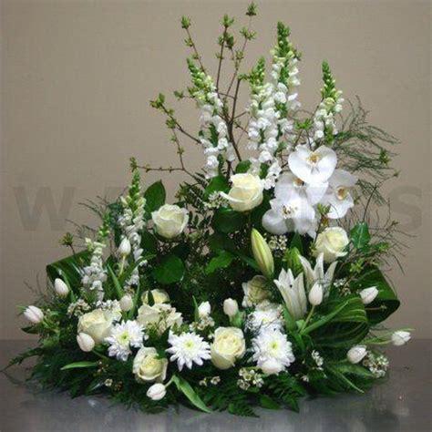 wreath  urn  white garden house floral studio