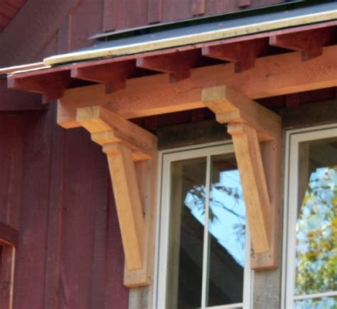 craftsman style exterior features knee braces support  small portico edged  exposed rafter