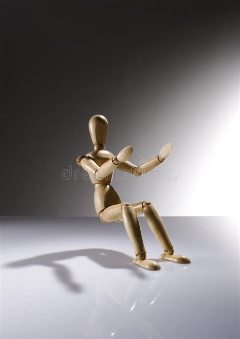 sitting wooden dummy stock photo image  clear