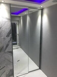 Slim Mirrored Wardrobe by Bespoke Fitted Sliding Wardrobe Mirror Glass Doors Made To