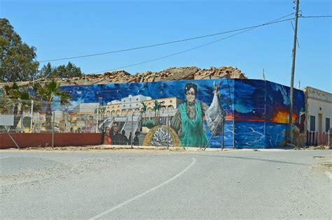 street art  brightly painted fish restaurant editorial