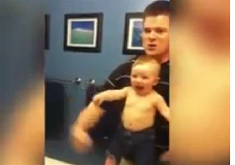awww baby boy imitates  father  flexing  muscles