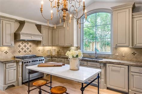 light gray french kitchen  marble french island