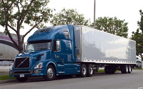 blue volvo vnl    ft trailer volvo vnl series