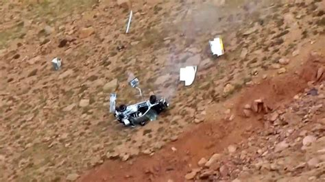 racecar driver jeremy foley plunges   cliff  rocky
