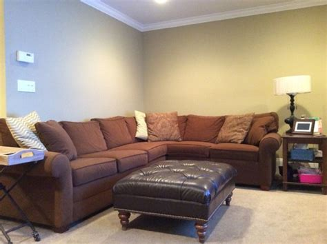 Brown Couch Living Room Wall Colors by Wall Decorations Above L Shaped Sectional Couch