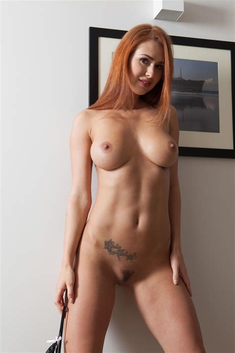 Alexandra Hot Busty Athletic Redhead