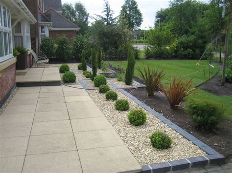 paving and gravel garden ideas marshalls saxon paving with golden gravel and blue black engineering brick edging and detail