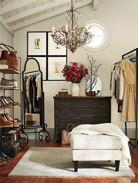 simple closet with an ottoman ny new designny new design