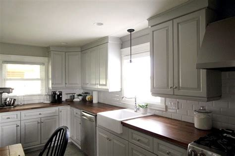 updating white kitchen cabinets updating our kitchen cabinets with new mouldings the 6685