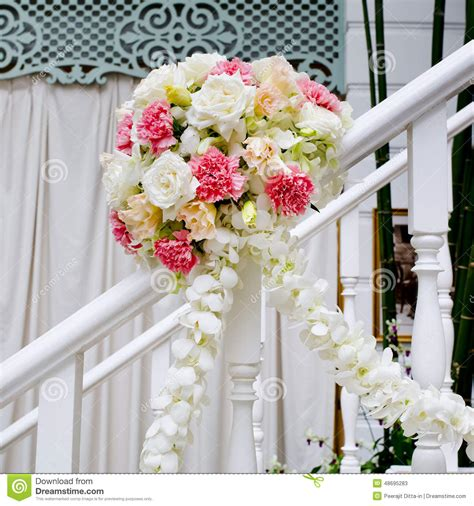 formal dining table floral arrangement beautiful wedding flower decoration at stairs stock photo