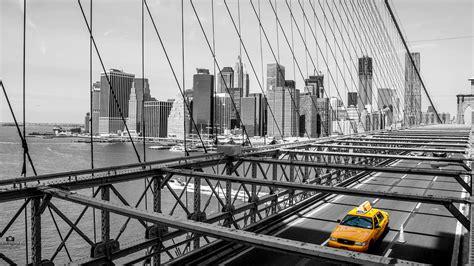 york brooklyn bridge yellow cab black  white