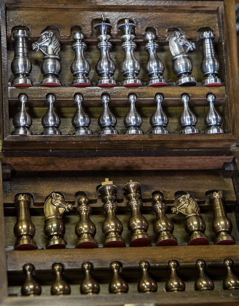 nice vintage chess set  heavy lacquered metal pieces