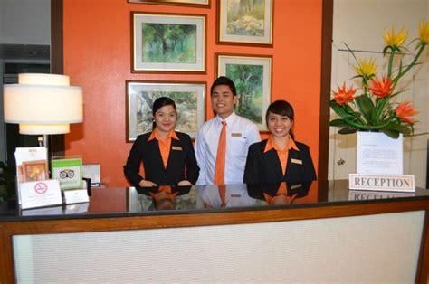 quality inn front desk uniforms hotel uniforms front desk deltin institute of learning