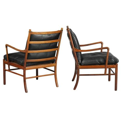 colonial pj149 armchairs and ottoman in rosewood by o