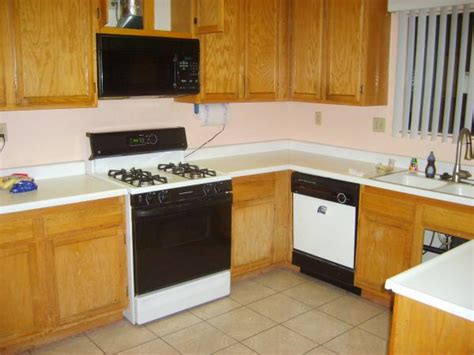 how to refresh kitchen cabinets best and cheapest way to refresh faded kitchen cabinet s 7329